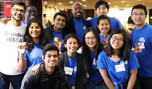 A group of Brandeis Business Students Standing Together Smiling