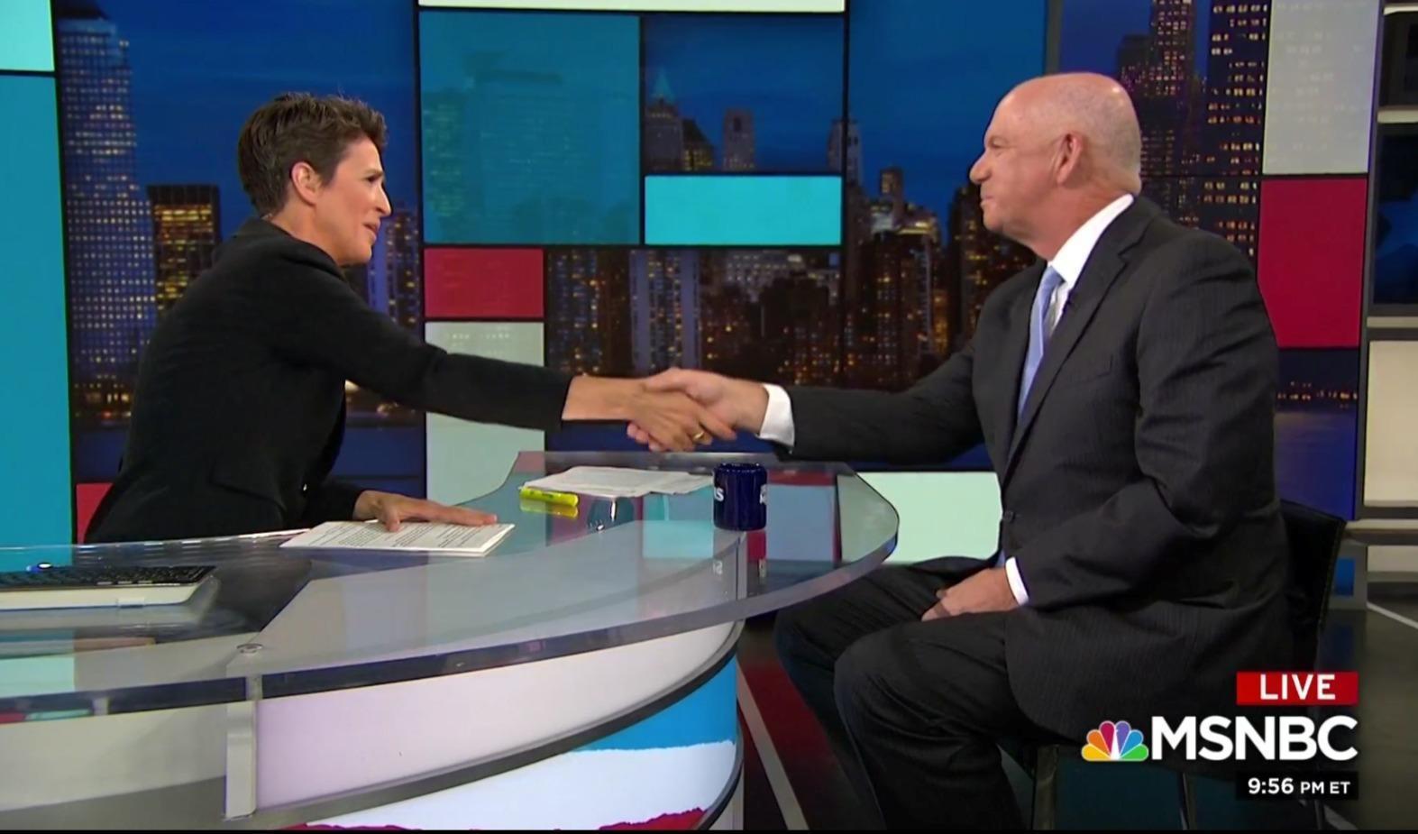 Rachel Maddow shaking hands with David Hickton
